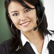 friendly customer service woman smiling at her office