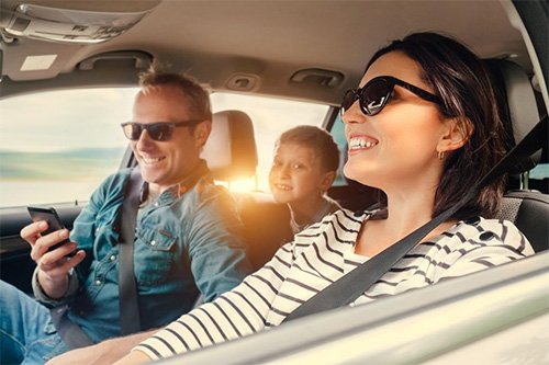 family in their car with title loan